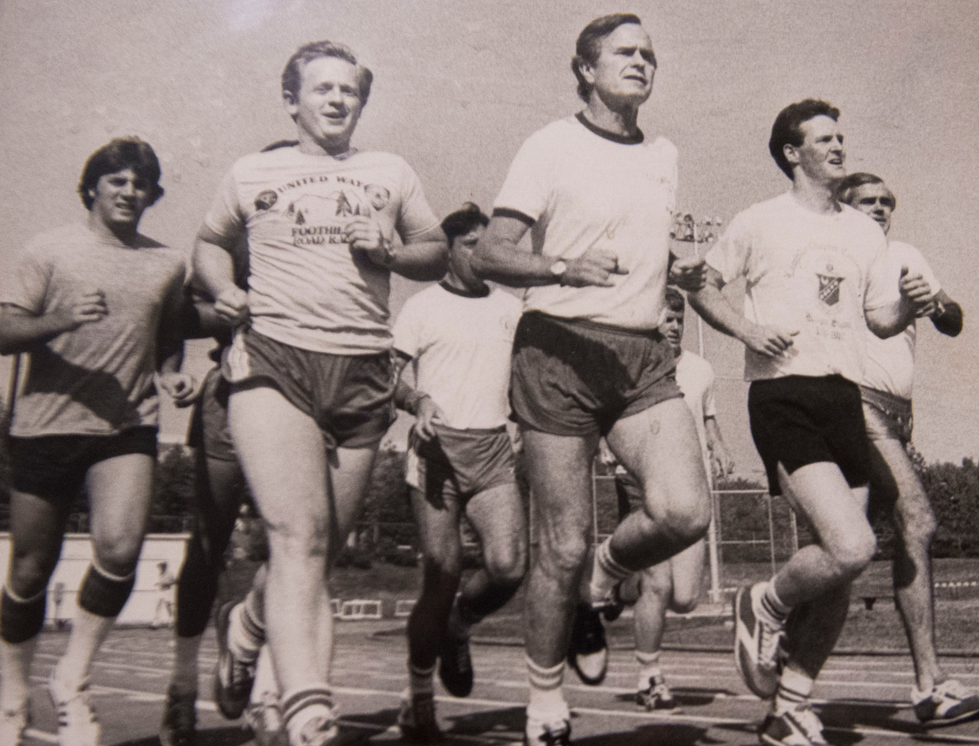 Victor Ashe and state Rep. Jimmy Hudson, right, jog at UT's Tom Black Track with presidential candidate George H.W. Bush and some Secret Service during Bush's May 1980 campaign stop in Knoxville. Months later, Bush would join the ticket with Ronald Reagan and be elected vice president.