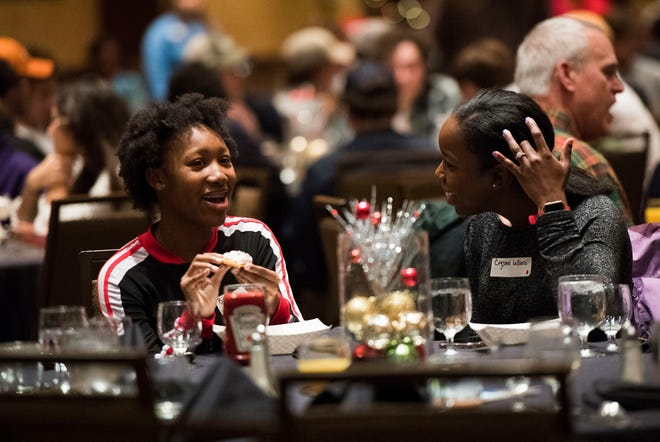 Breia Jackson, 14, and Crystal LeBlanc chat at Big Brothers Big Sisters annual holiday party at the Crowne Plaza Saturday, Dec. 1, 2018. Nearly 300 mentors, mentees and family members were in attendance.