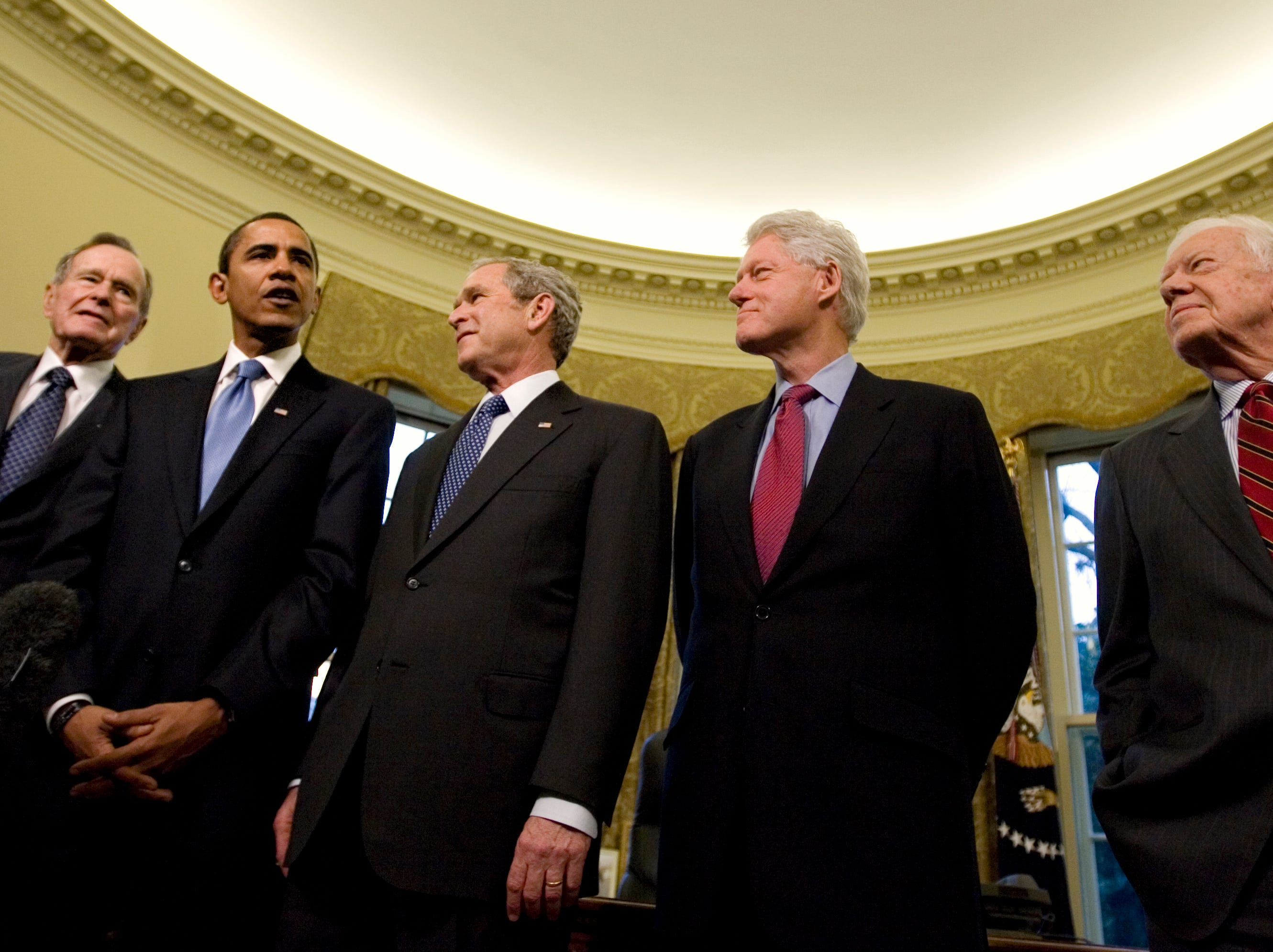 President George W. Bush hosts President-elect Barack Obama, and former presidents, from left, George H.W. Bush,  Bill Clinton and Jimmy Carter, on Jan. 7, 2009, at the White House. The photograph is part of an Associated Press exhibit titled 'The American President' that will be on display at the Baker Center for Public Policy beginning Wednesday. (AP Photo/J. Scott Applewhite)