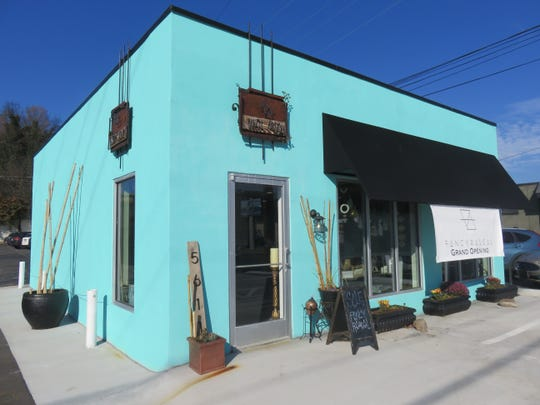 Fancy Rascal has given former tax service building a new teal blue look.