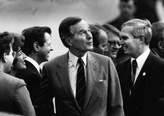 Greeters for President George H.W. Bush's visit on Feb. 2, 1990, at McGhee Tyson Air National Guard base included Second District Rep. John J. Duncan Jr., right.