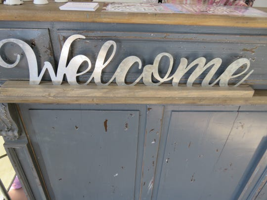 "The ""Welcome"" sign is out at Fancy Rascal."
