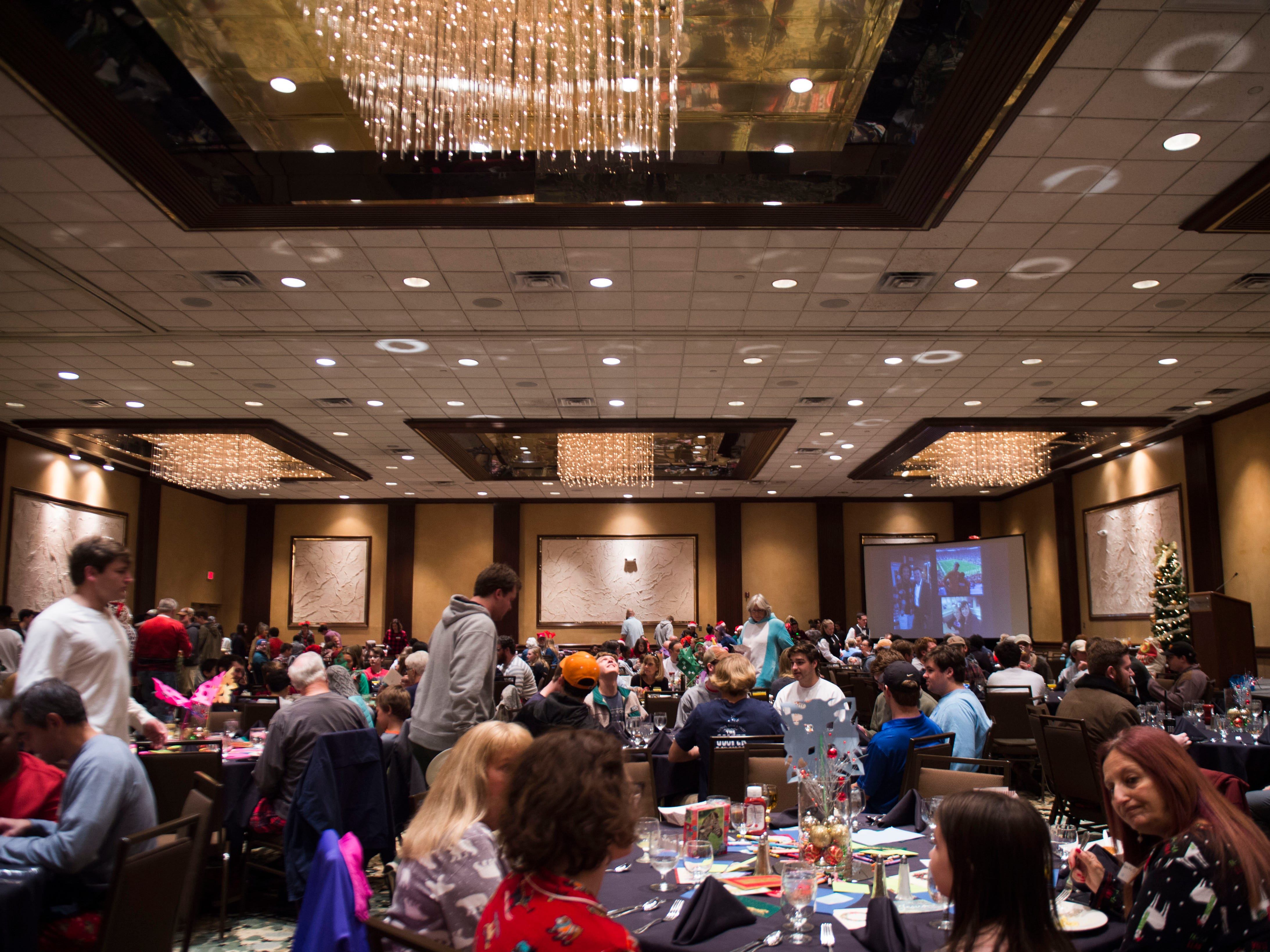 Big Brothers Big Sisters participants gather at the Crowne Plaza for their annual holiday party Saturday, Dec. 1, 2018. Nearly 300 mentors, mentees and family members were in attendance.