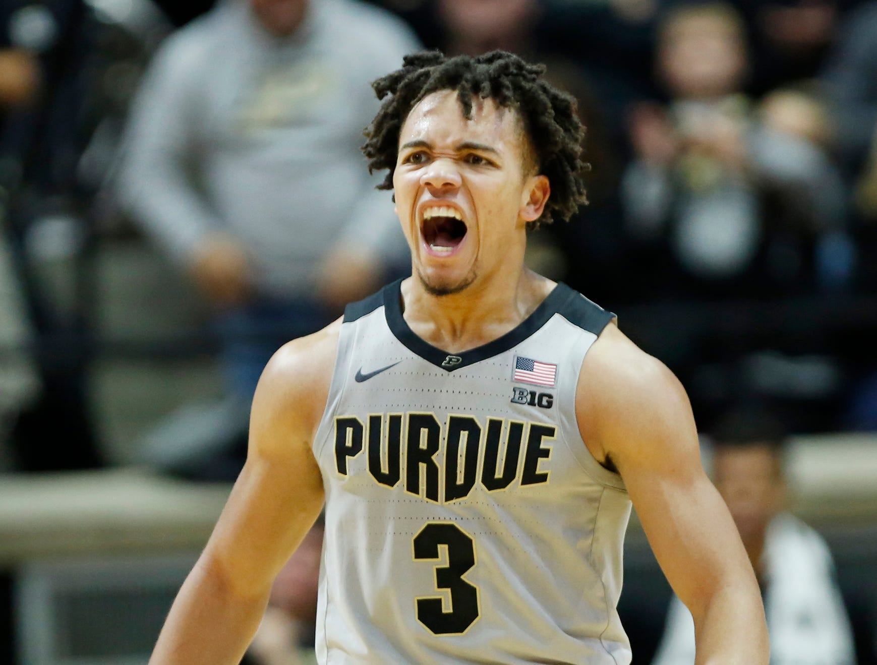 Carsen Edwards of Purdue lets out a scream after a bucket by teammate Nojel Eastern put the Boilermakers up 69-52 over Ball State with 11:23 remaining Saturday, November 10, 2018, at Mackey Arena. Purdue defeated Ball State 84-75.