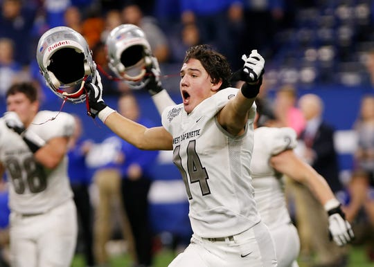 Yanni Karlaftis of West Lafayette celebrates after the Red Devils hold on to defeat Evansville Memorial 47-42 in the Class 3A State Championship Saturday, November 24, 2018, at Lucas Oil Stadium in Indianapolis.