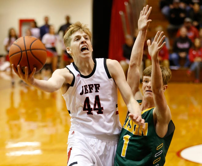Braxton Barnhizer of Lafayette Jeff drives past Chase Creek of Benton Central in the Franciscan Health Hoops Classic Friday, November 30, 2018, at Lafayette Jeff. Barnhizer had 21 points to lead the Bronchos over Benton Central 67-42.