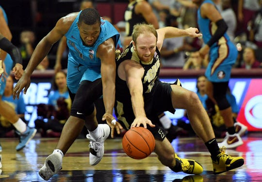 Nov 28, 2018; Tallahassee, FL, USA; Purdue Boilermakers forward Evan Boudreaux (12) and Florida State Seminoles forward Raiquan Gray (1) fight for a loose ball during the second half at Donald L. Tucker Center. Mandatory Credit: Melina Myers-USA TODAY Sports