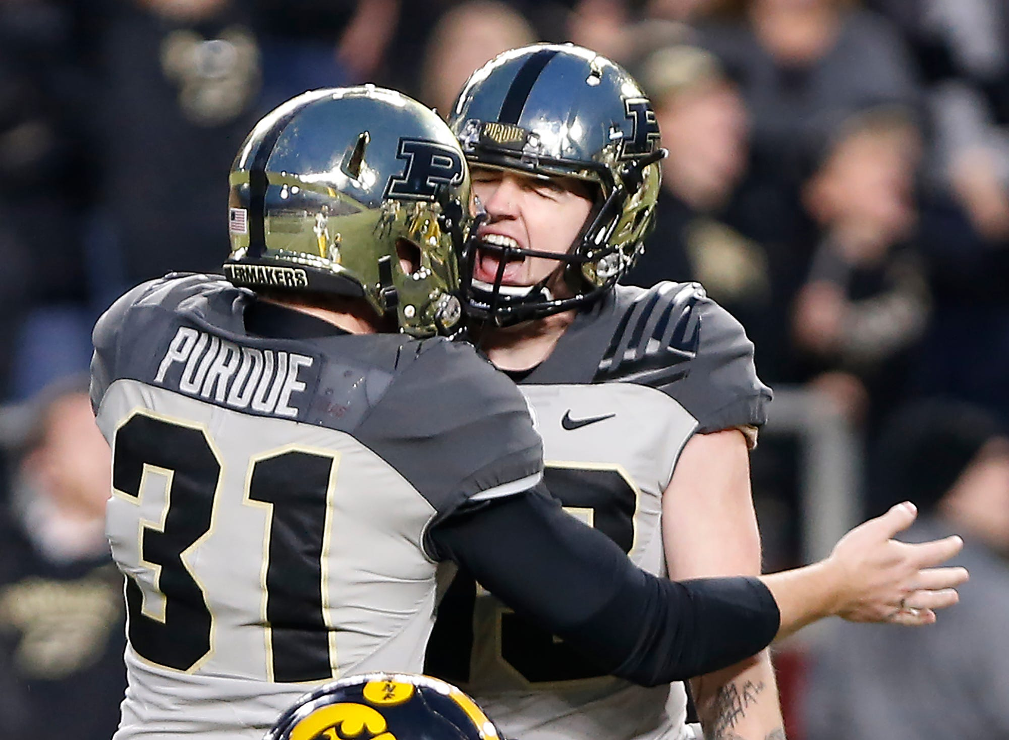 Purdue kicker Spencer Evans, right, celebrates with Joe Schopper after his field goal put the Boilermakers up 38-36 over Iowa Saturday, November 3, 2018, at Ross-Ade Stadium.