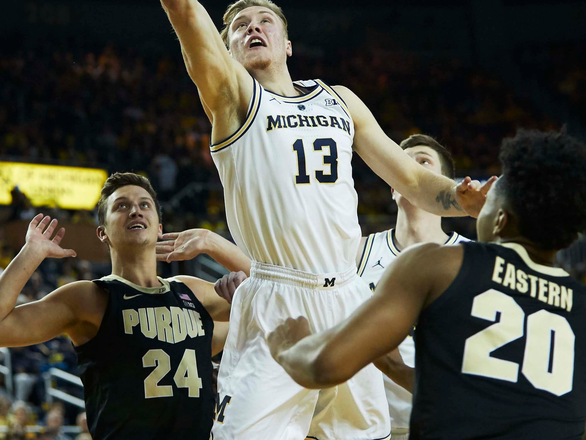 Dec 1, 2018; Ann Arbor, MI, USA; Michigan Wolverines forward Ignas Brazdeikis (13) shoots on Purdue Boilermakers guard Nojel Eastern (20) in the first half at Crisler Center. Mandatory Credit: Rick Osentoski-USA TODAY Sports
