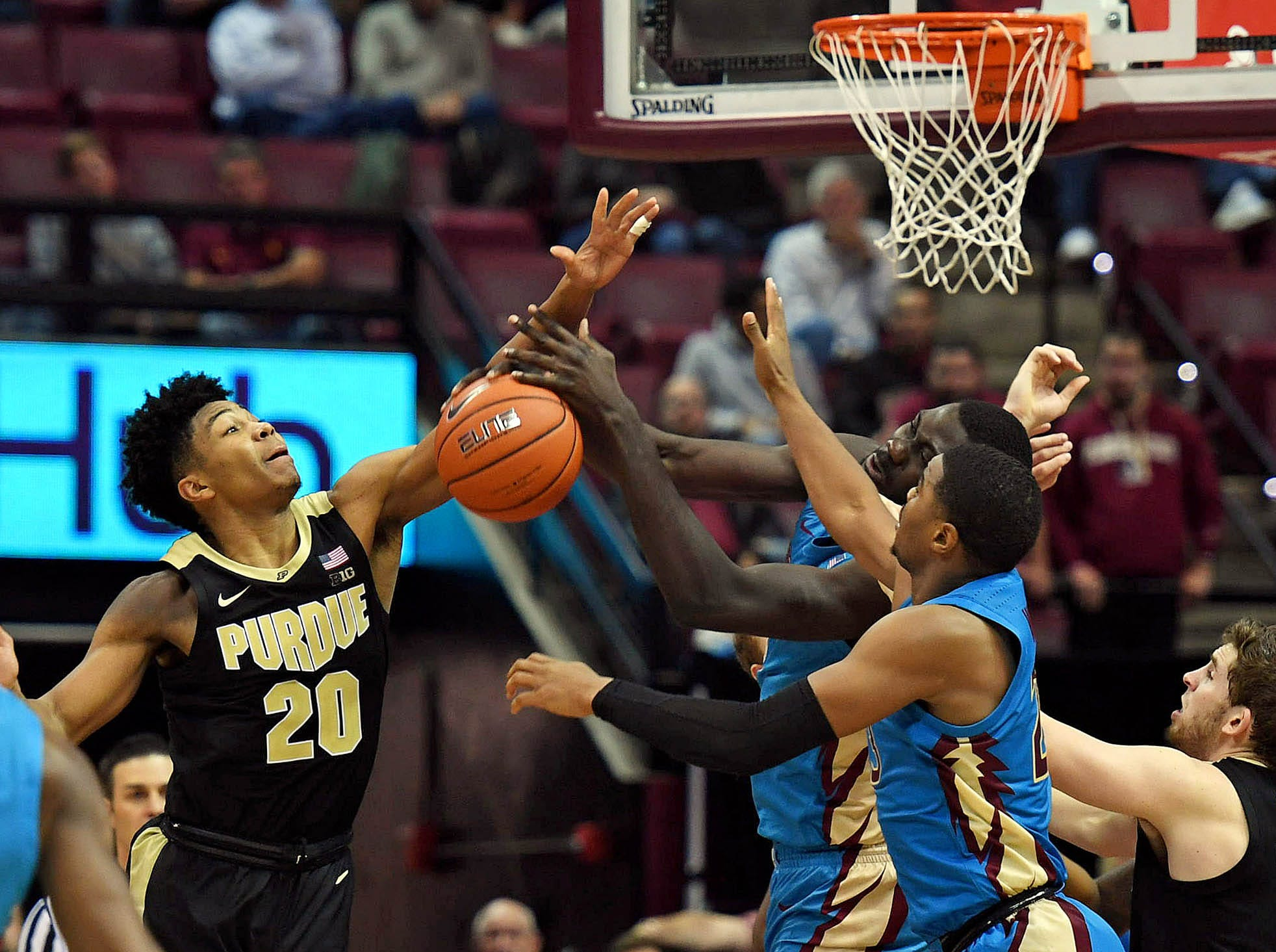 Nov 28, 2018; Tallahassee, FL, USA; Purdue Boilermakers guard Nojel Eastern (20) defends the basket as Florida State Seminoles center Christ Koumadje (21) during the second half at Donald L. Tucker Center. Mandatory Credit: Melina Myers-USA TODAY Sports