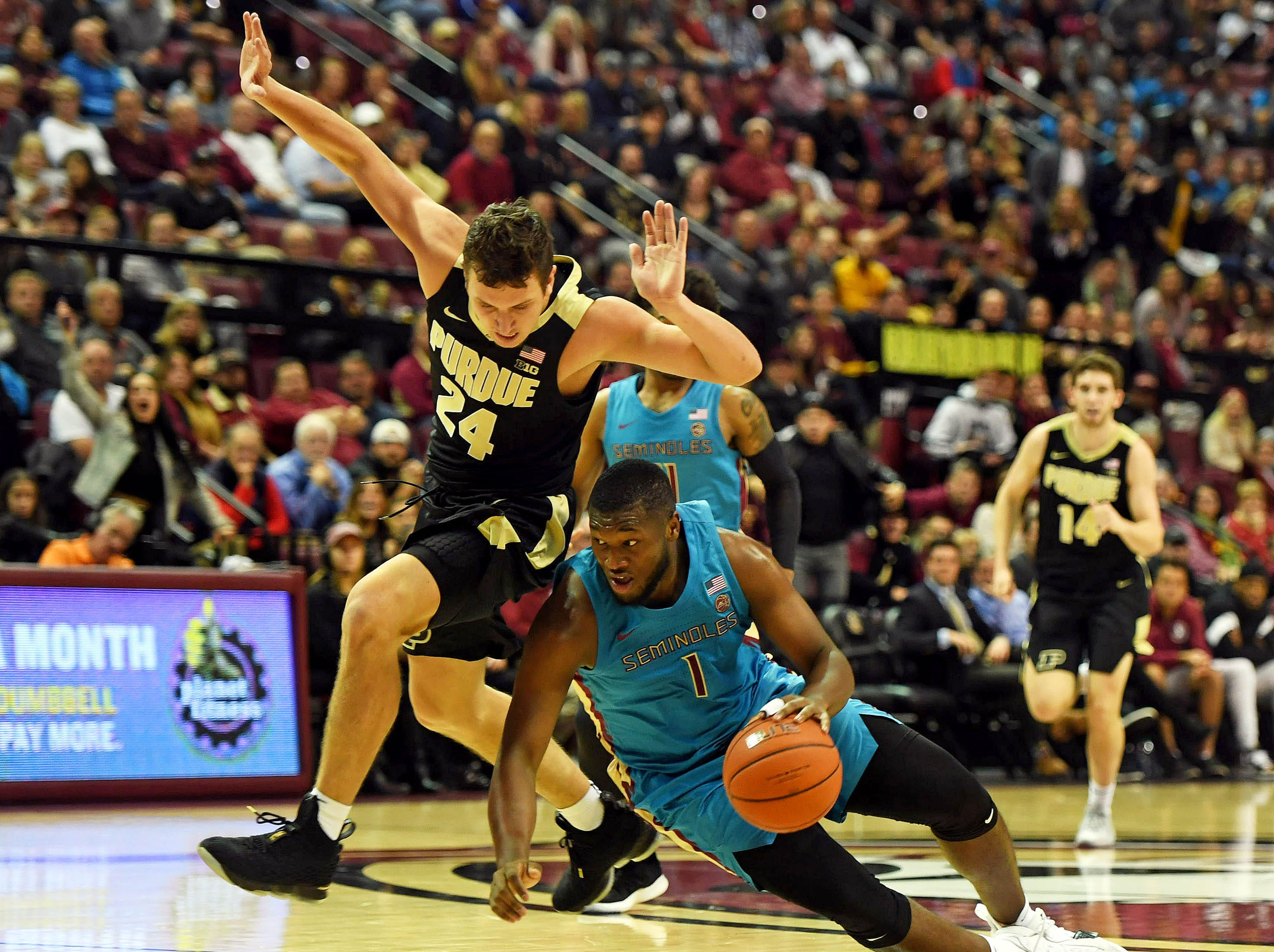 Nov 28, 2018; Tallahassee, FL, USA; Purdue Boilermakers forward Grady Eifert (24) and Florida State Seminoles forward Raiquan Gray (1) fight for a loose ball during the second half at Donald L. Tucker Center. Mandatory Credit: Melina Myers-USA TODAY Sports