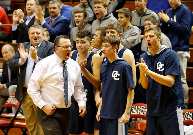 Head coach David Barrett and the Central Catholic bench erupt after Brenner Oliver scores and draws a foul against Harrison in the Franciscan Health Hoops Classic Friday, November 30, 2018, at Lafayette Jeff. CC defeated Harrison 67-53.