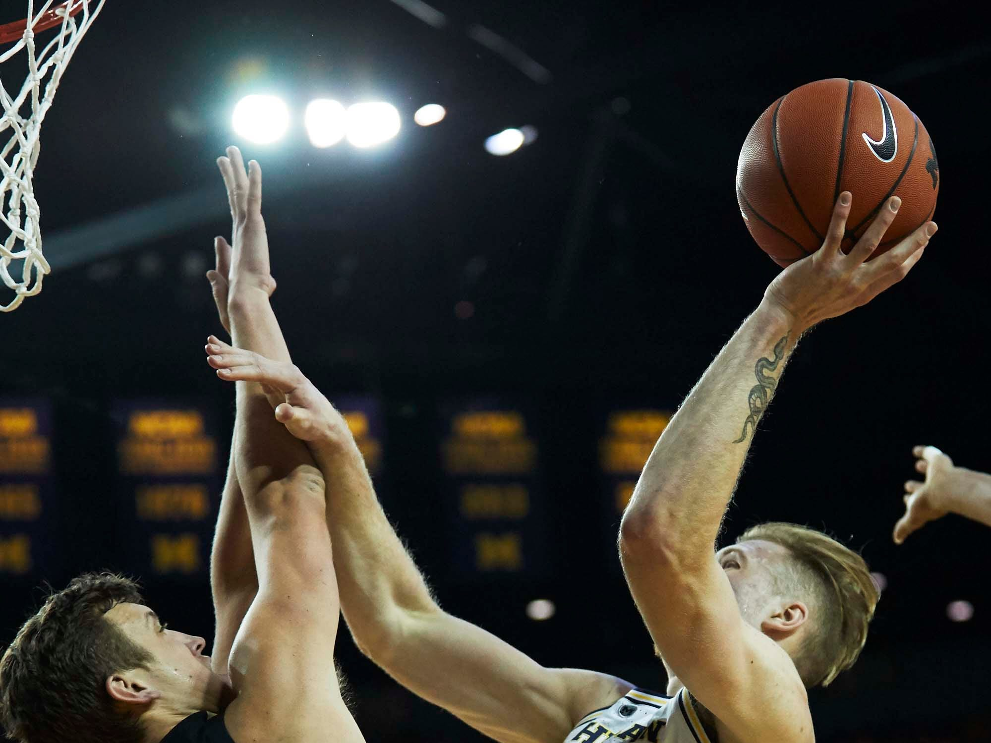Dec 1, 2018; Ann Arbor, MI, USA; Michigan Wolverines forward Ignas Brazdeikis (13) shoots on Purdue Boilermakers forward Grady Eifert (24) in the first half at Crisler Center. Mandatory Credit: Rick Osentoski-USA TODAY Sports