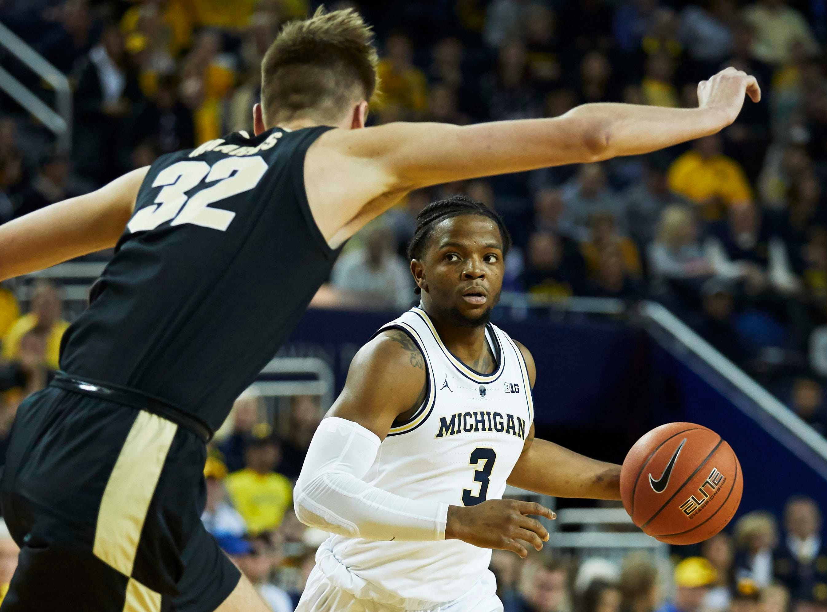 Dec 1, 2018; Ann Arbor, MI, USA; Michigan Wolverines guard Zavier Simpson (3) dribbles defended by Purdue Boilermakers center Matt Haarms (32) in the first half at Crisler Center. Mandatory Credit: Rick Osentoski-USA TODAY Sports