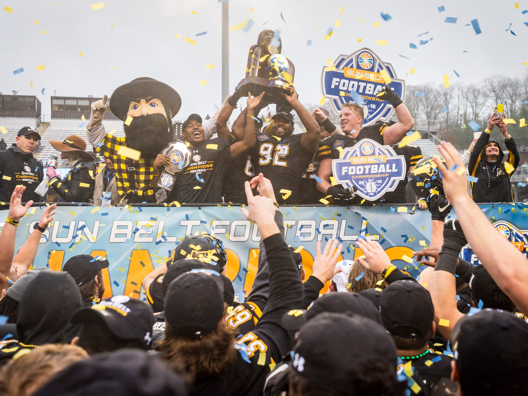 Appalachian State  defensive lineman MyQuon Stout (92) celebrates with his teammates after the Mountaineers defeated Louisiana 30-19 in the Sunbelt Championship on Saturday, Dec. 1, 2018 in Boone, N.C.