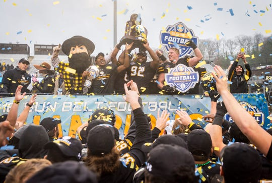 Appalachian State celebrates its 2018 Sun Belt Conference championship game win over UL. The same two teams meet for the 2019 title on Saturday in Boone, North Carolina.