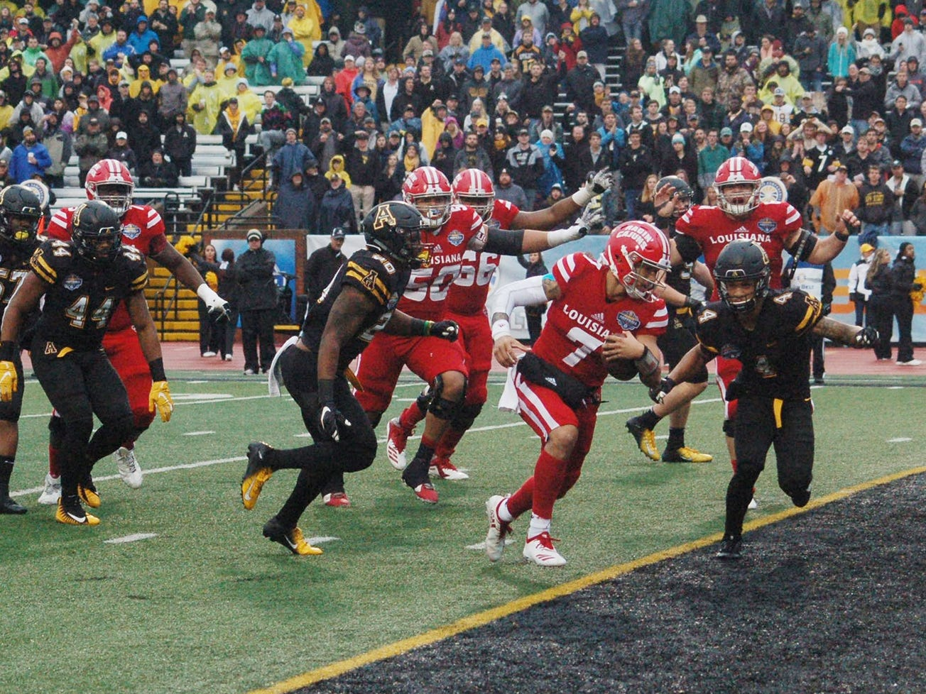UL quarterback Andre Nunez scores a touchdown before Appalachian State's Clifton Duck (4) can reach him Saturday in the Sun Belt Championship in Boone, North Carolina.