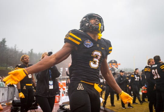 Appalachian State running back Darrynton Evans (3) celebrates in the closing moments of the Mountaineers' victory over UL in the 2018 Sun Belt Championship on Dec. 1 in Boone, North Carolina.