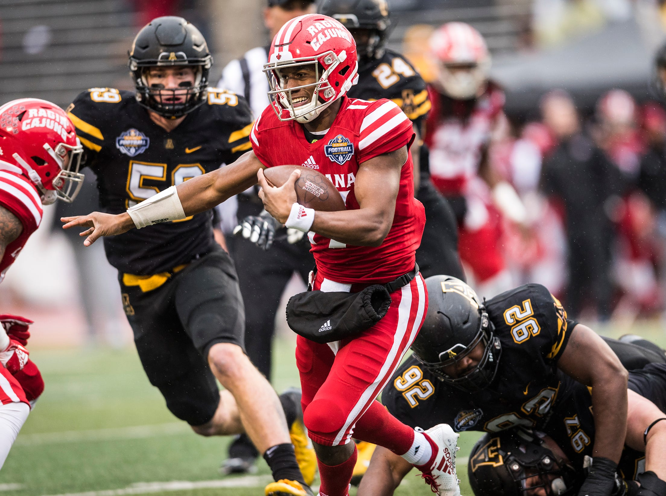 Louisiana  quarterback Levi Lewis (17) runs the ball on Saturday, Dec. 1, 2018 in Boone, N.C.