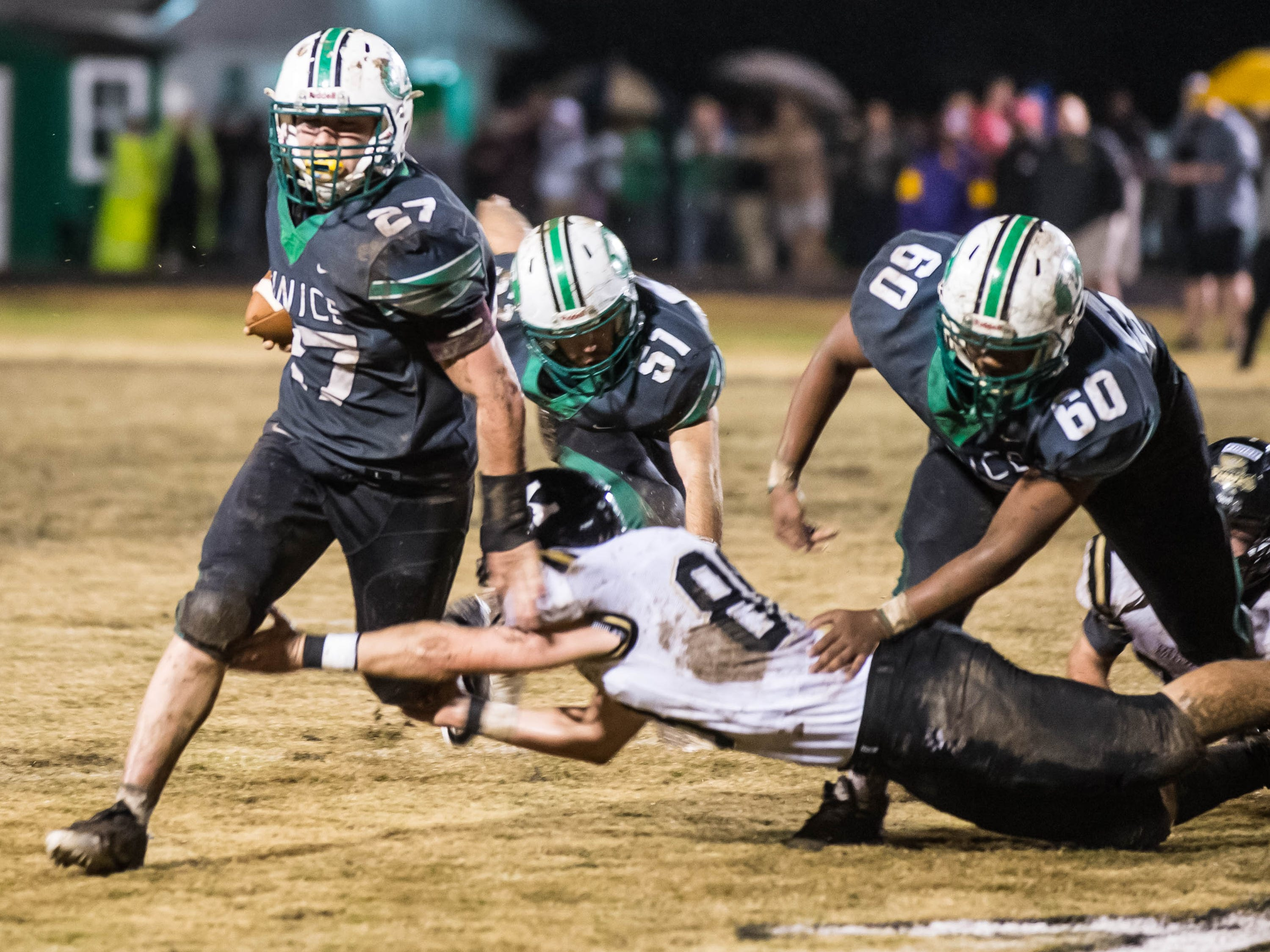 Euncie High's Avery Lee (27) breaks the tackle to get to the outside for another first down as the Bobcats take on the Kaplan High Pirates in the LHSAA Class 3A semifinal game Friday Nov. 30, 2018.