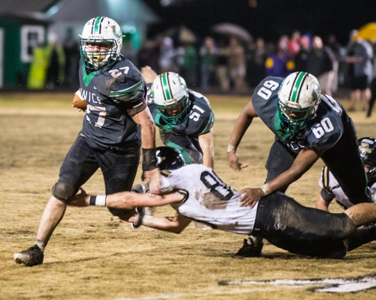 Eunice's 'Mr. Everything' Avrey Lee (27), shown here running the ball in the state semifinals, was recognized as the Defensive MVP on the Class 3A All-State football team.