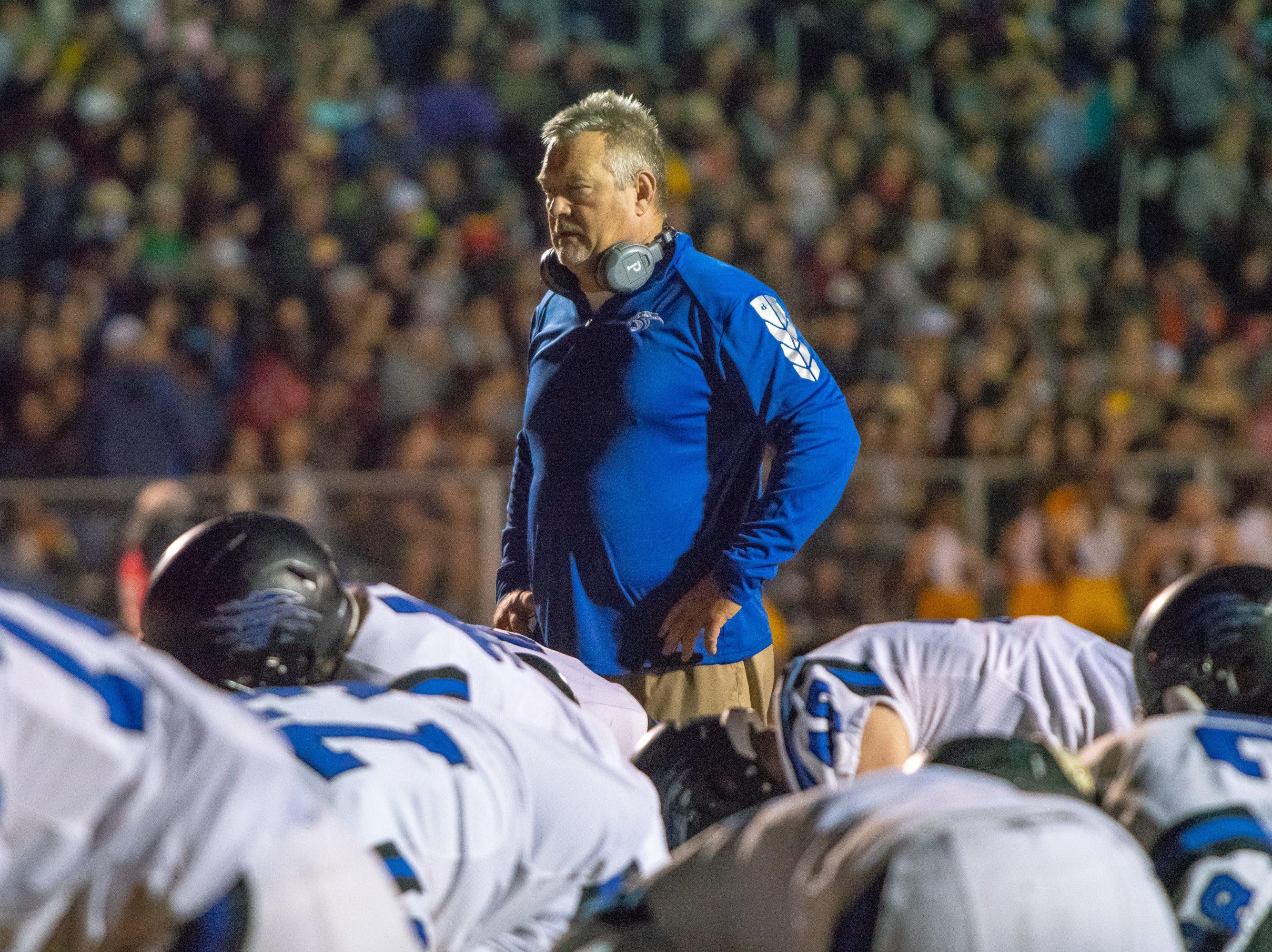 Sterlington's head coach Lee Doty watches over his team during warmups as the Iota Bulldogs take on the Sterlington Panthers in an LHSAA playoff football game on Friday, Nov. 30, 2018.
