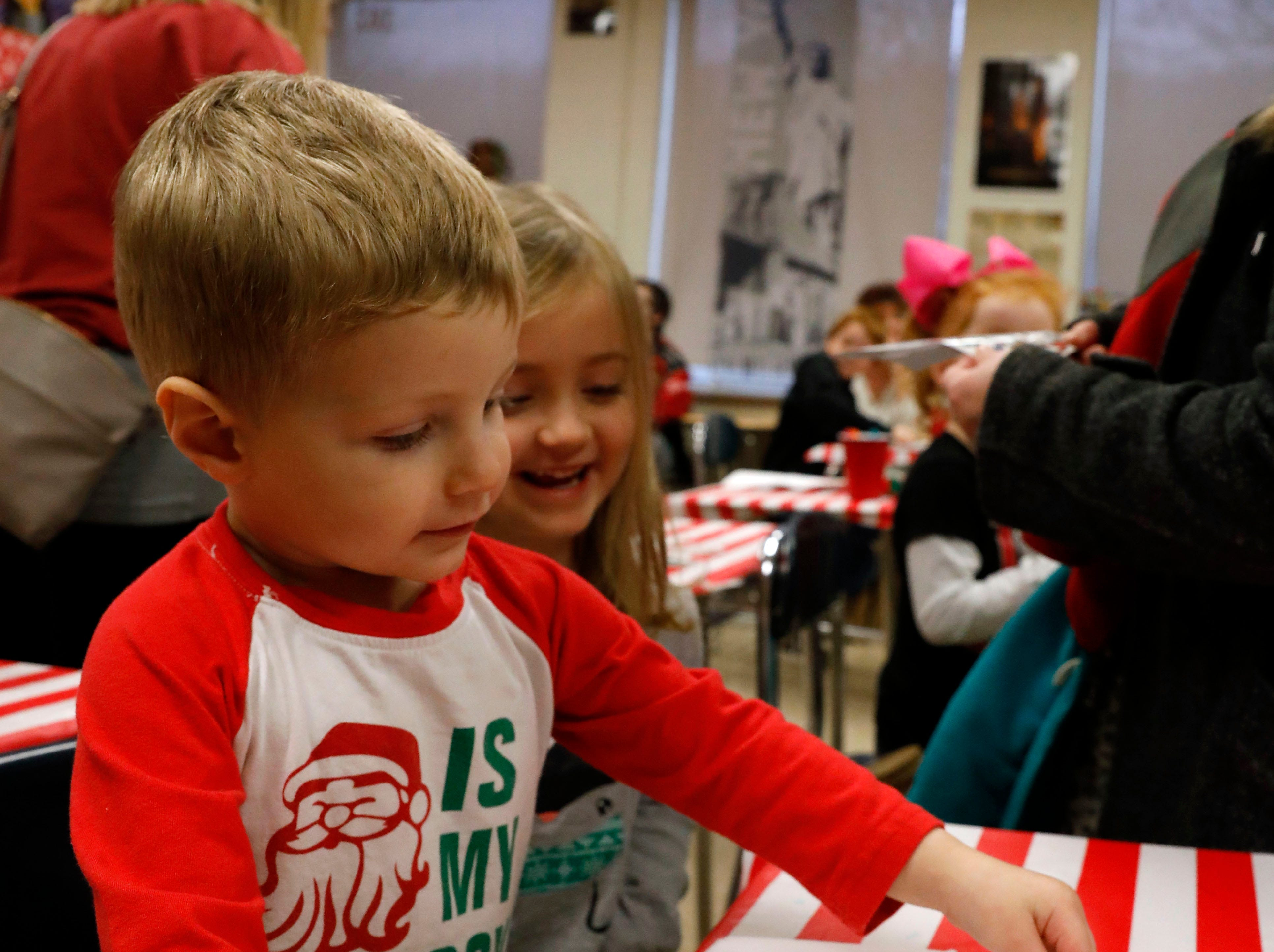 The Gift of Time was held Saturday, Dec. 1, 2018, at Lancaster High School in Lancaster. The annual free community event featured activities from children younger than 8 and their families. More than 20 community organizations provided stations ranging from cookie decorating, story book reading, gift bag decoration and photographs with Santa Claus.