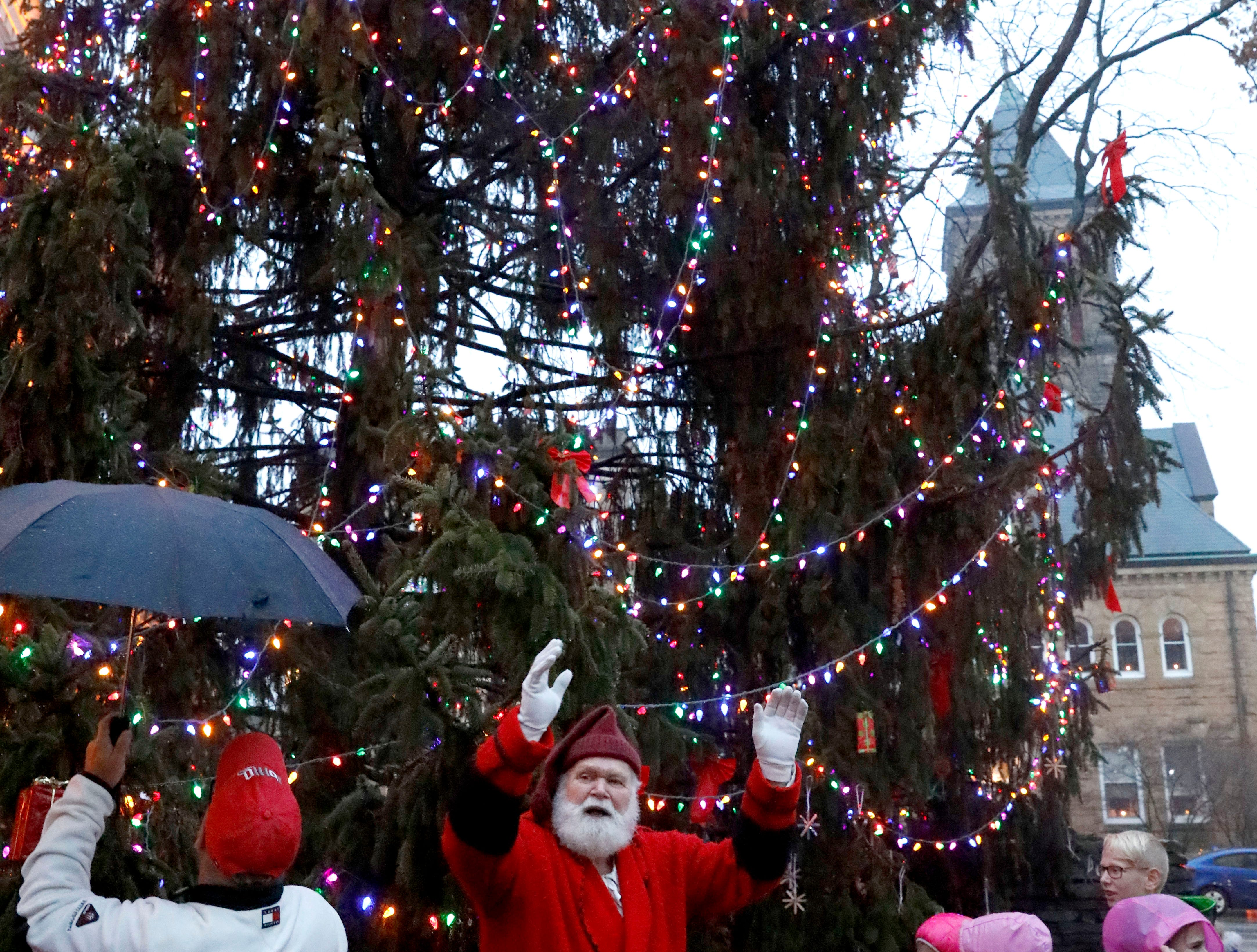 Santa Claus celebrates as the downtown Christmas tree lights up Saturday night, Dec. 1, 2018, in Lancaster. The tree lighting ceremony capped off the annual Winterfest in downtown Lancaster.