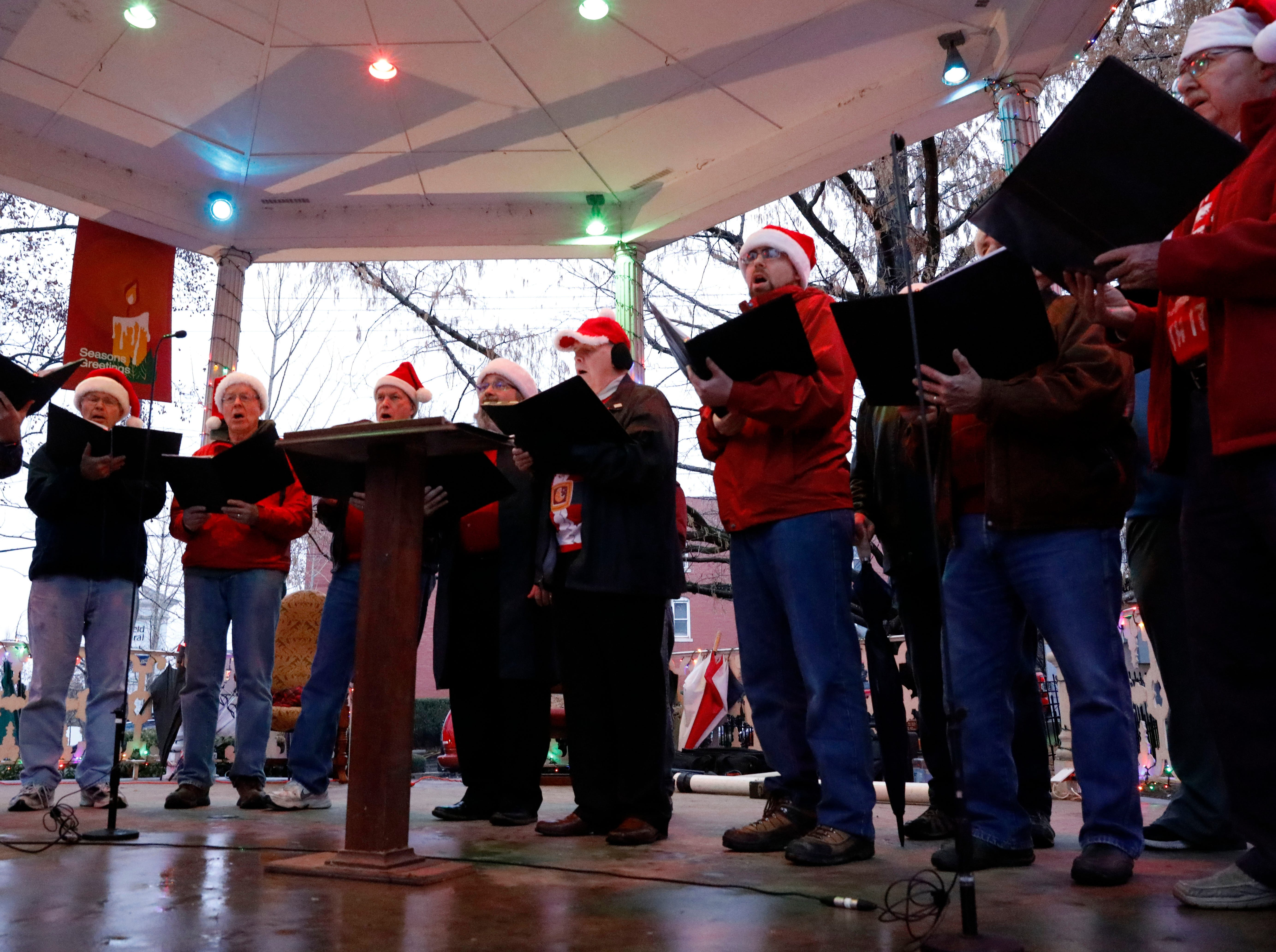 Members of the Lancaster Men's Chorus perform at the tree lighting ceremony Saturday night, Dec. 1, 2018, in downtown Lancaster.