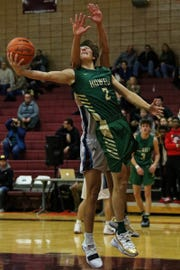 Howell's Luke Russo (2) puts up a shot in the Highlanders' 72-28 loss at Okemos on Friday, Nov. 30, 2018.