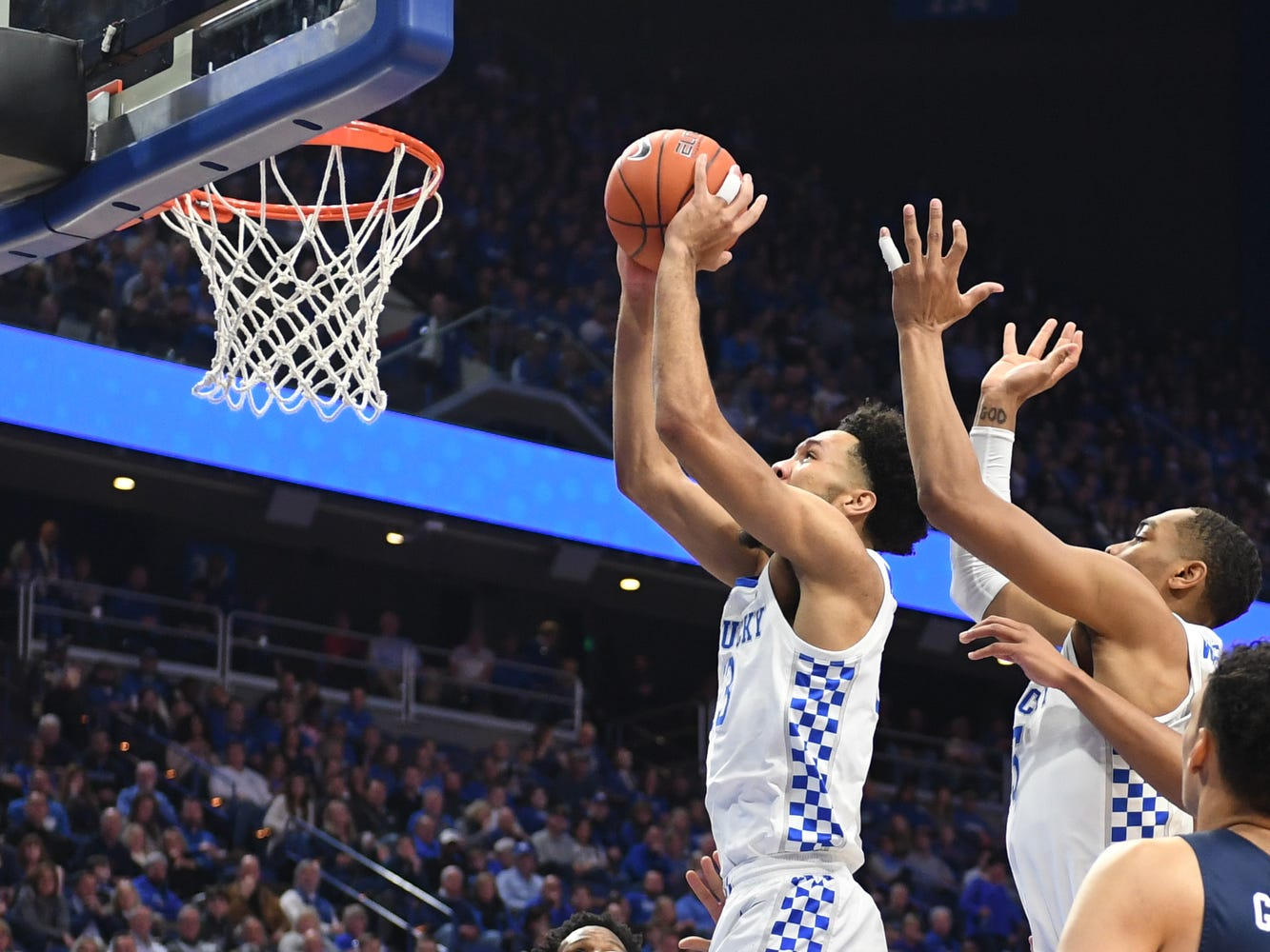 UK F EJ Montgomery puts the ball up after a rebound during the University of Kentucky men's basketball game against UNC Greensboro at Rupp Arena in Lexington, Kentucky on Saturday, December 1, 2018.