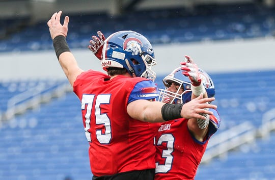 CAL's Brandt Babin, right, celebrates his touchdown over Mayfield with teammate John Young at the 2A KHSAA Championship at Kroger Field in Lexington Dec. 1, 2018.