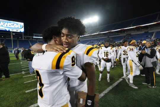 Central QB Malik Goodall (1) embraced teammate Mykah Williams (9) after they defeated Corbin 20-19 during the Class 3A championship at Kroger Field in Lexington.  