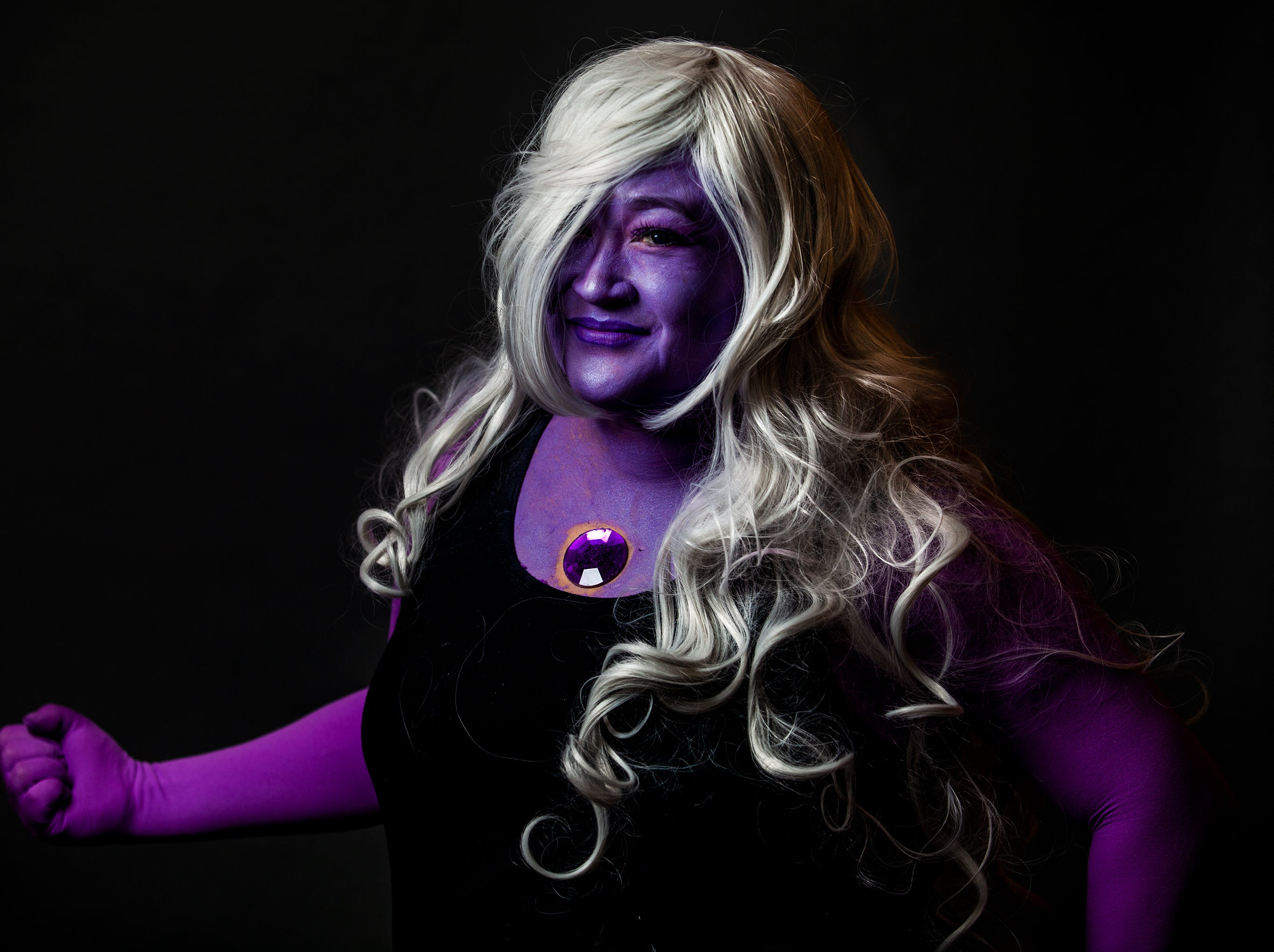 Donna Mulkins poses as Amethyst for the Louisville Supercon at the Kentucky International Convention Center on Friday, Nov. 30, 2018.