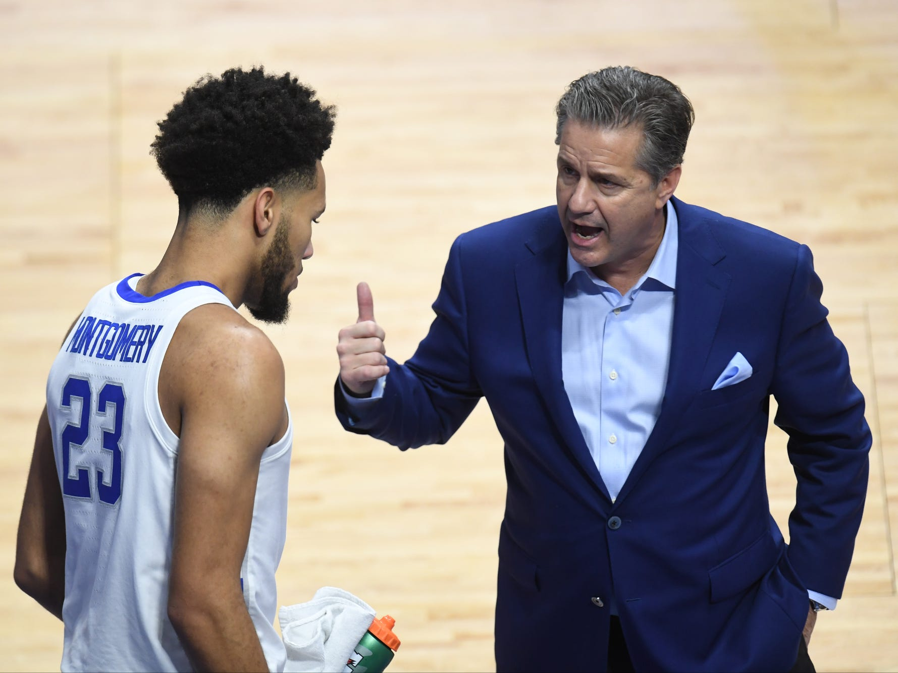 UK F EJ Montgomery listens to head coach John Calipari during the University of Kentucky men's basketball game against UNC Greensboro at Rupp Arena in Lexington, Kentucky on Saturday, December 1, 2018.