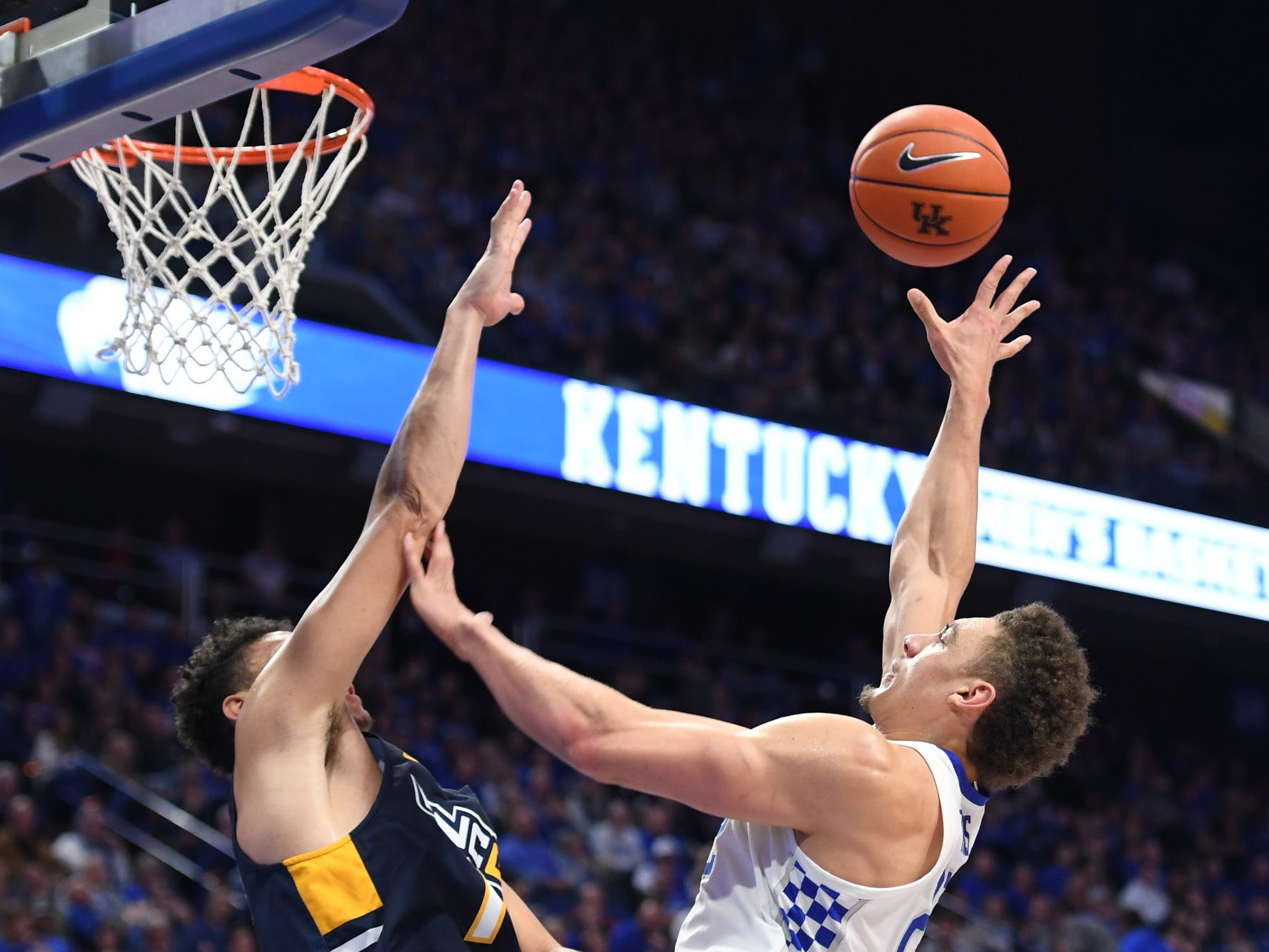 UK F Reid Travis puts up the ball during the University of Kentucky men's basketball game against UNC Greensboro at Rupp Arena in Lexington, Kentucky on Saturday, December 1, 2018.