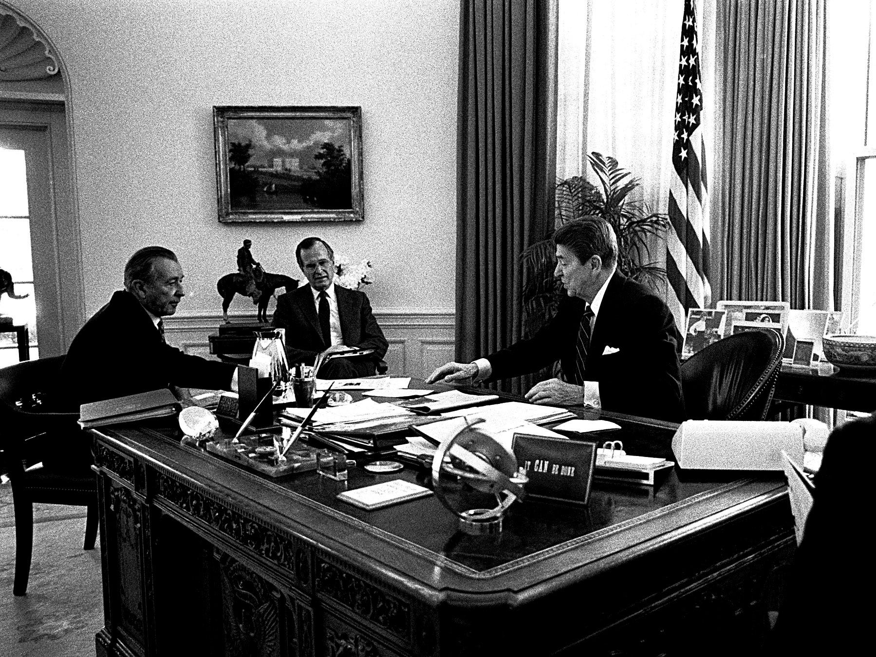 President Reagan holds a meeting in the Oval Office with chief of staff Don Regan,left, vice-president George Bush, and longtime staffer Michael Deaver, right. April, 1985.