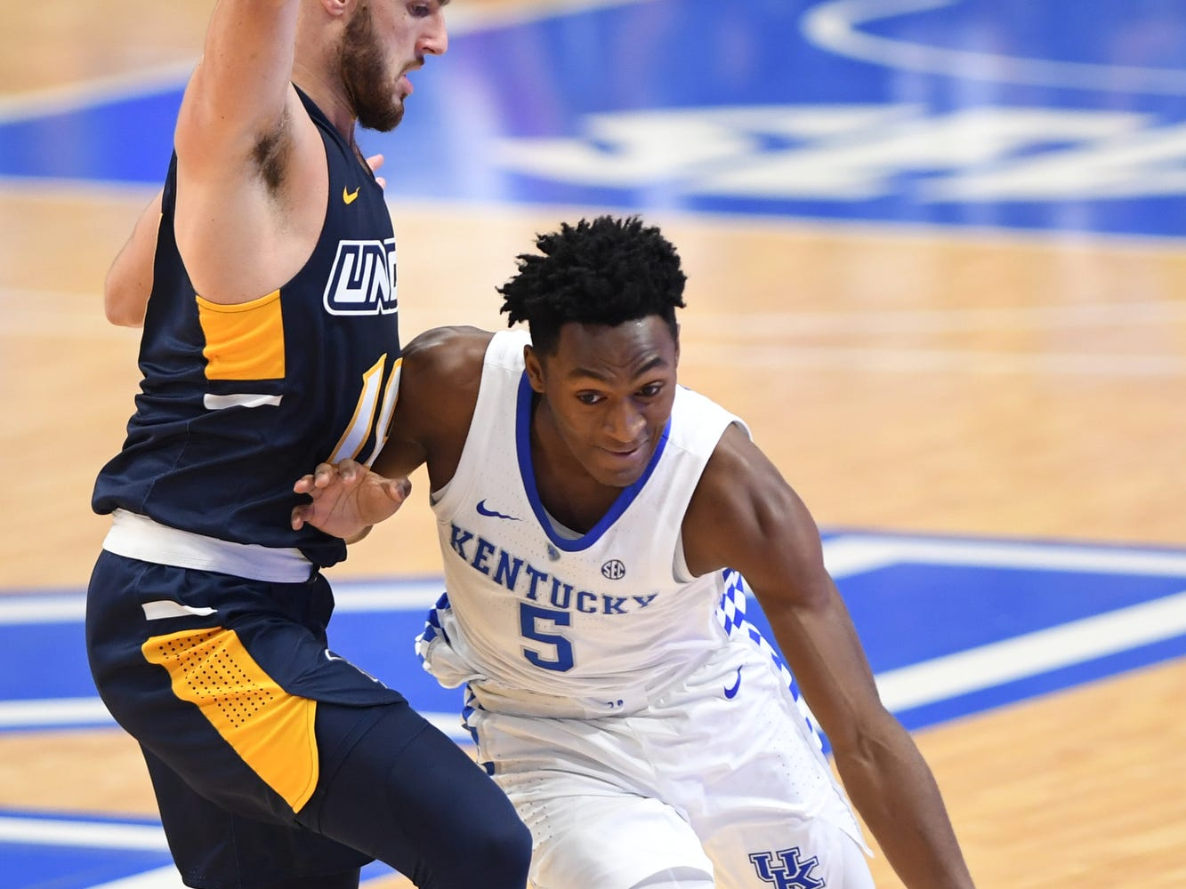 UK G Immanuel Quickley brings the ball up court during the University of Kentucky men's basketball game against UNC Greensboro at Rupp Arena in Lexington, Kentucky on Saturday, December 1, 2018.