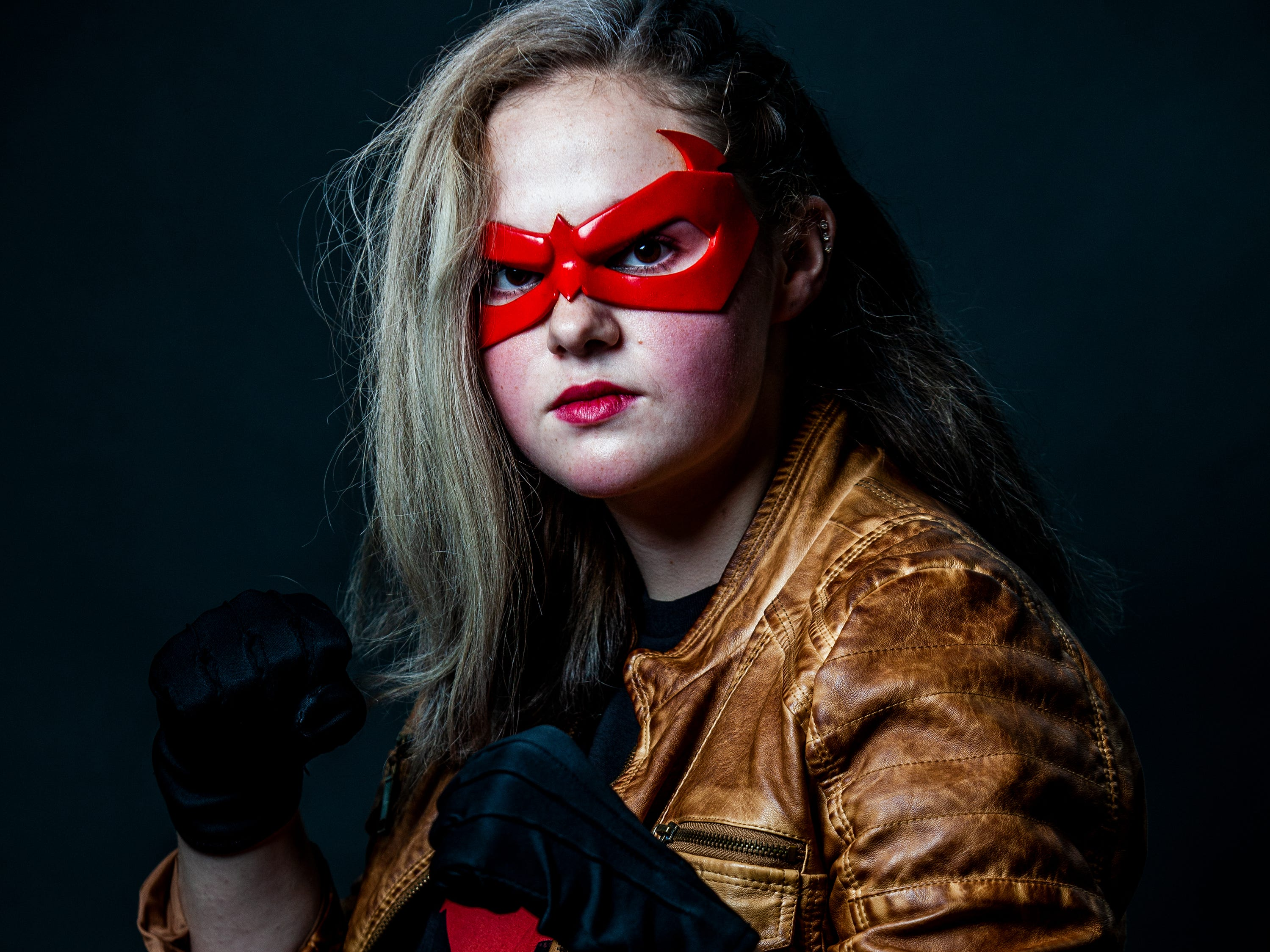 Mattie Heppner poses as Red Hood for the Louisville Supercon at the Kentucky International Convention Center on Saturday, Dec. 1, 2018.
