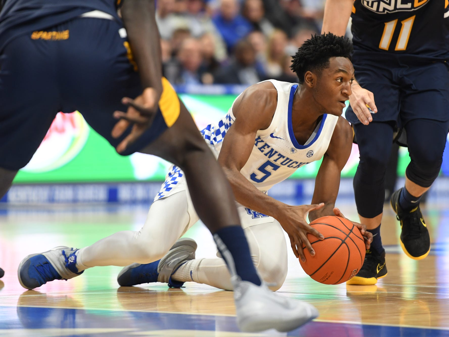 UK G Immanuel Quickley grabs the ball during the University of Kentucky men's basketball game against UNC Greensboro at Rupp Arena in Lexington, Kentucky on Saturday, December 1, 2018.