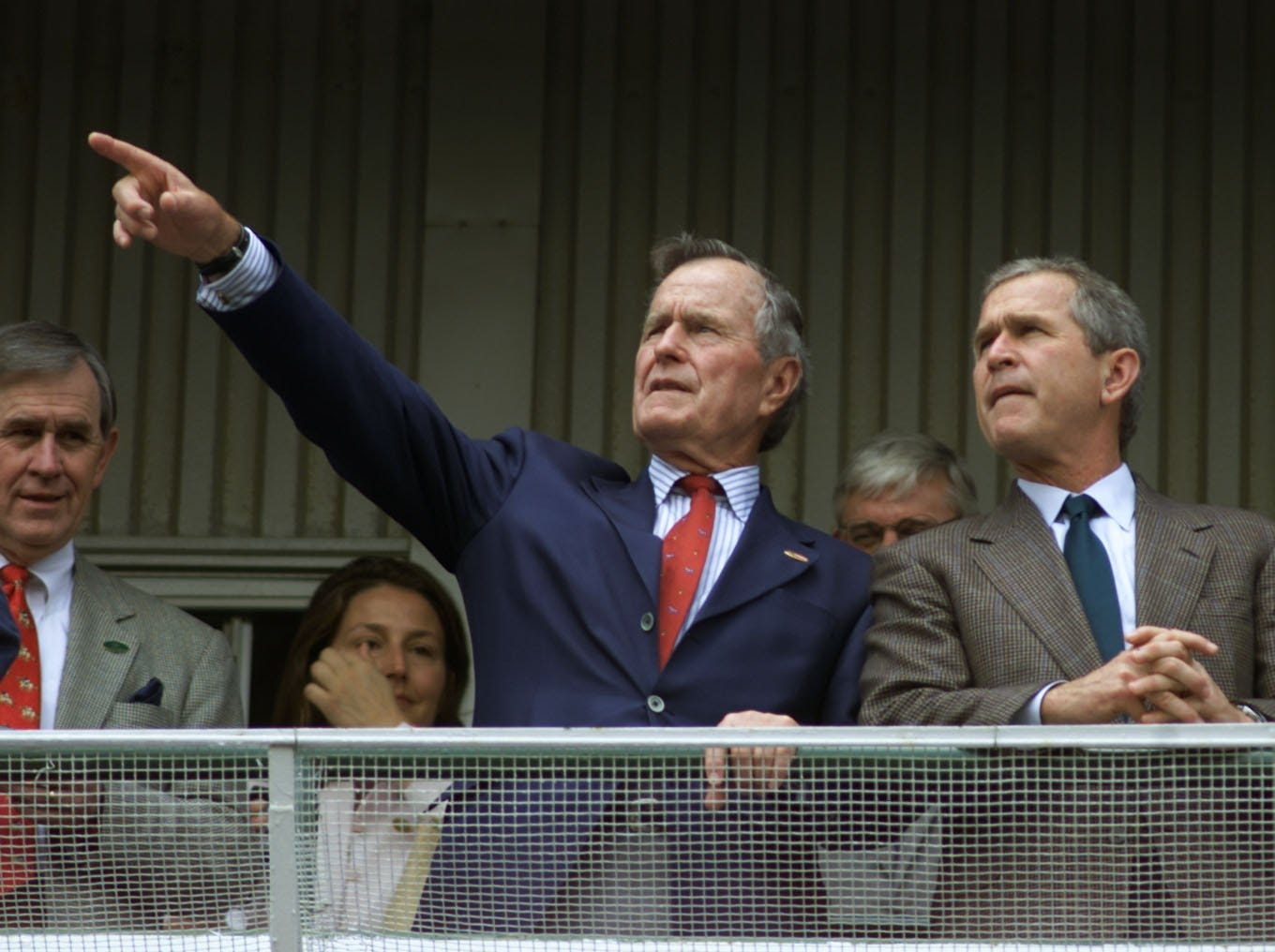 Former President George Bush, left, and his son George W. Bush looked out on the Skye Terrace as they waited fourth race at Churchill Downs.-