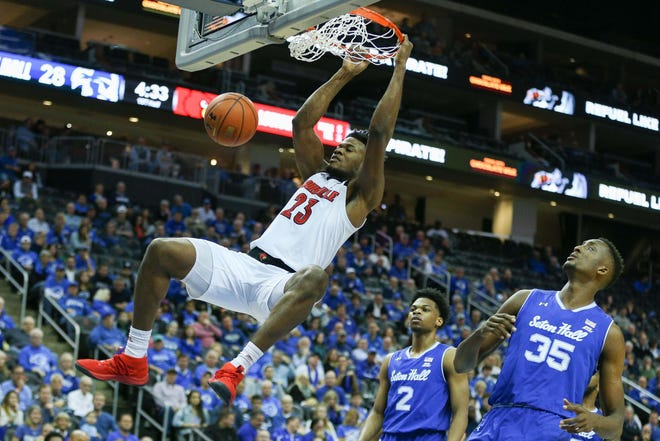 Dec 1, 2018; Newark, NJ, USA; Louisville Cardinals center Steven Enoch (23) dunks in front of Seton Hall Pirates center Romaro Gill (35) Seton Hall Pirates center Romaro Gill (35) and forward Darnell Brodie (32) during the first at Prudential Center. Mandatory Credit: Vincent Carchietta-USA TODAY Sports