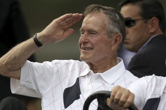 Former Pres. George H.W. Bush saluted the crowd on the ninth hole._(By Michael Clevenger, The Courier-Journal)_9.19.08