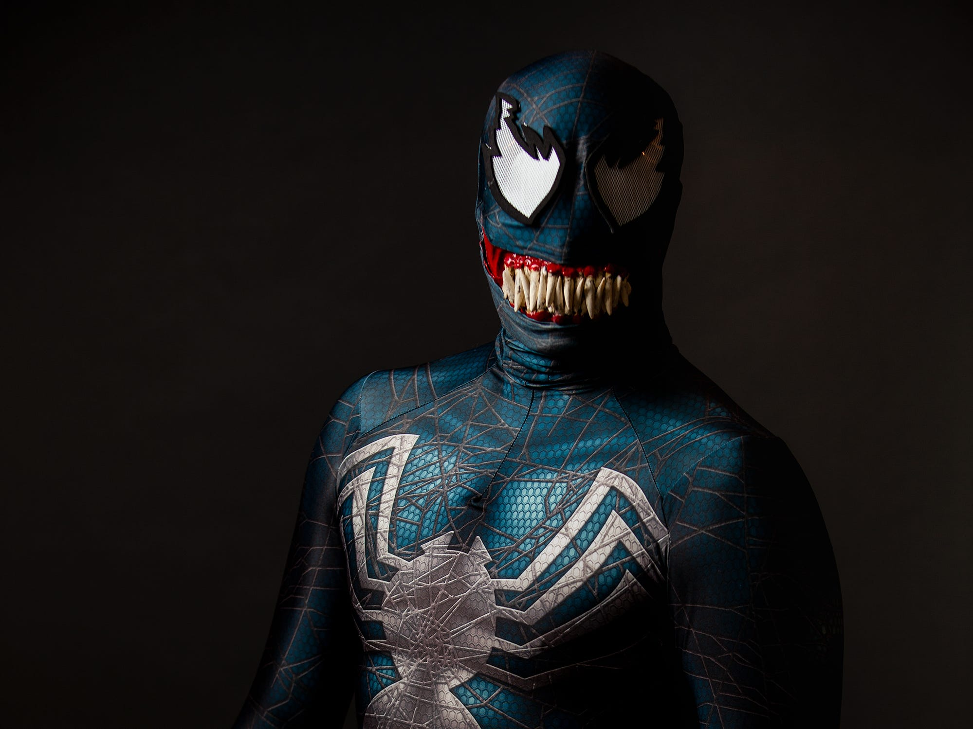 Doug Crews poses as Venom for the Louisville Supercon at the Kentucky International Convention Center on Friday, Nov. 30, 2018.