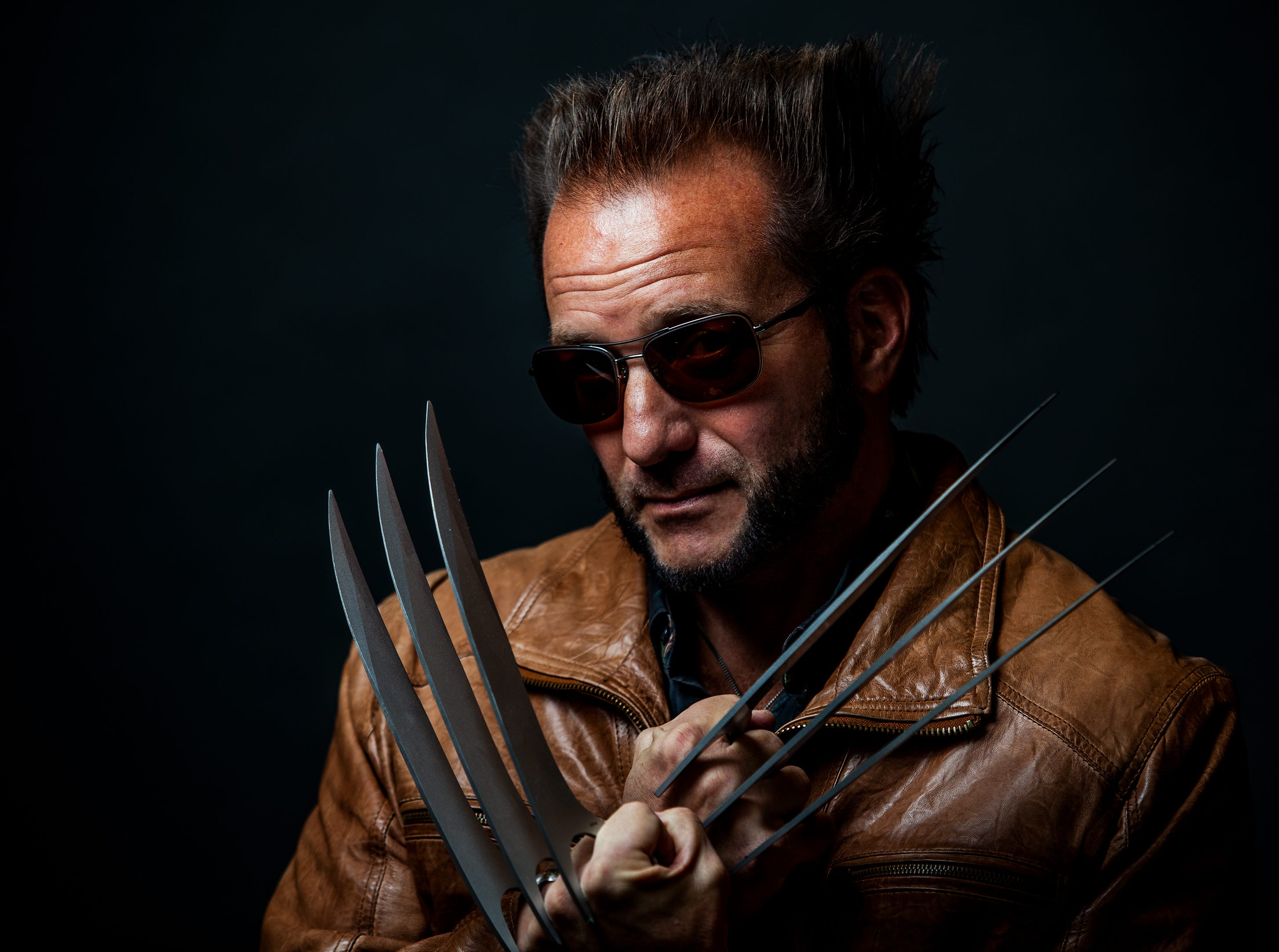Dave Tullock poses as Wolverine for the Louisville Supercon at the Kentucky International Convention Center on Friday, Nov. 30, 2018.