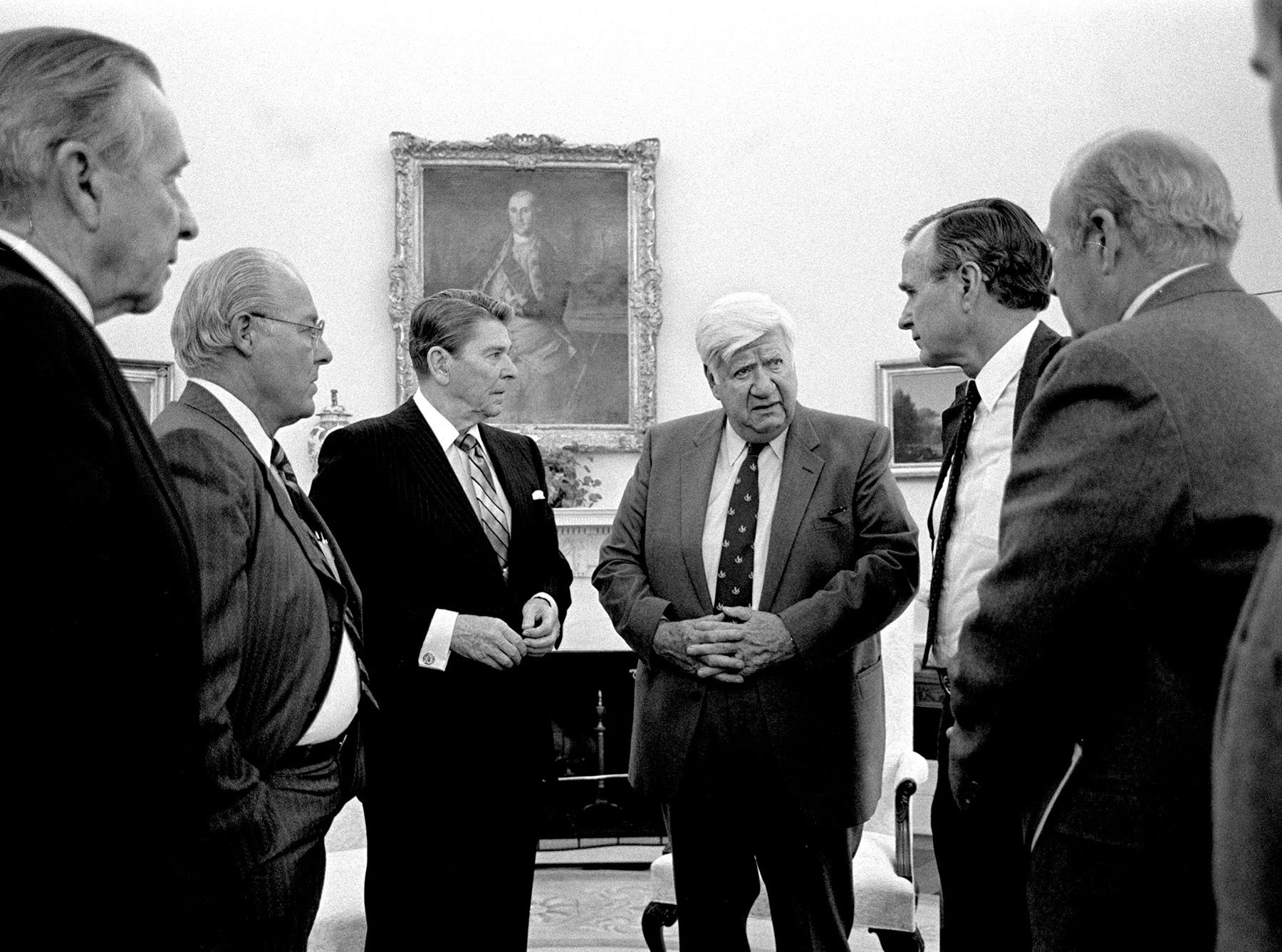 President Reagan, third from left,talks with Speaker of the House Tip O'Neil in the Oval Office along with chief of staff Don Regan, left, Rep. Robert Michael, Vice-President George H. W. Bush, and Secretary of State George Schultz, April, 1985.