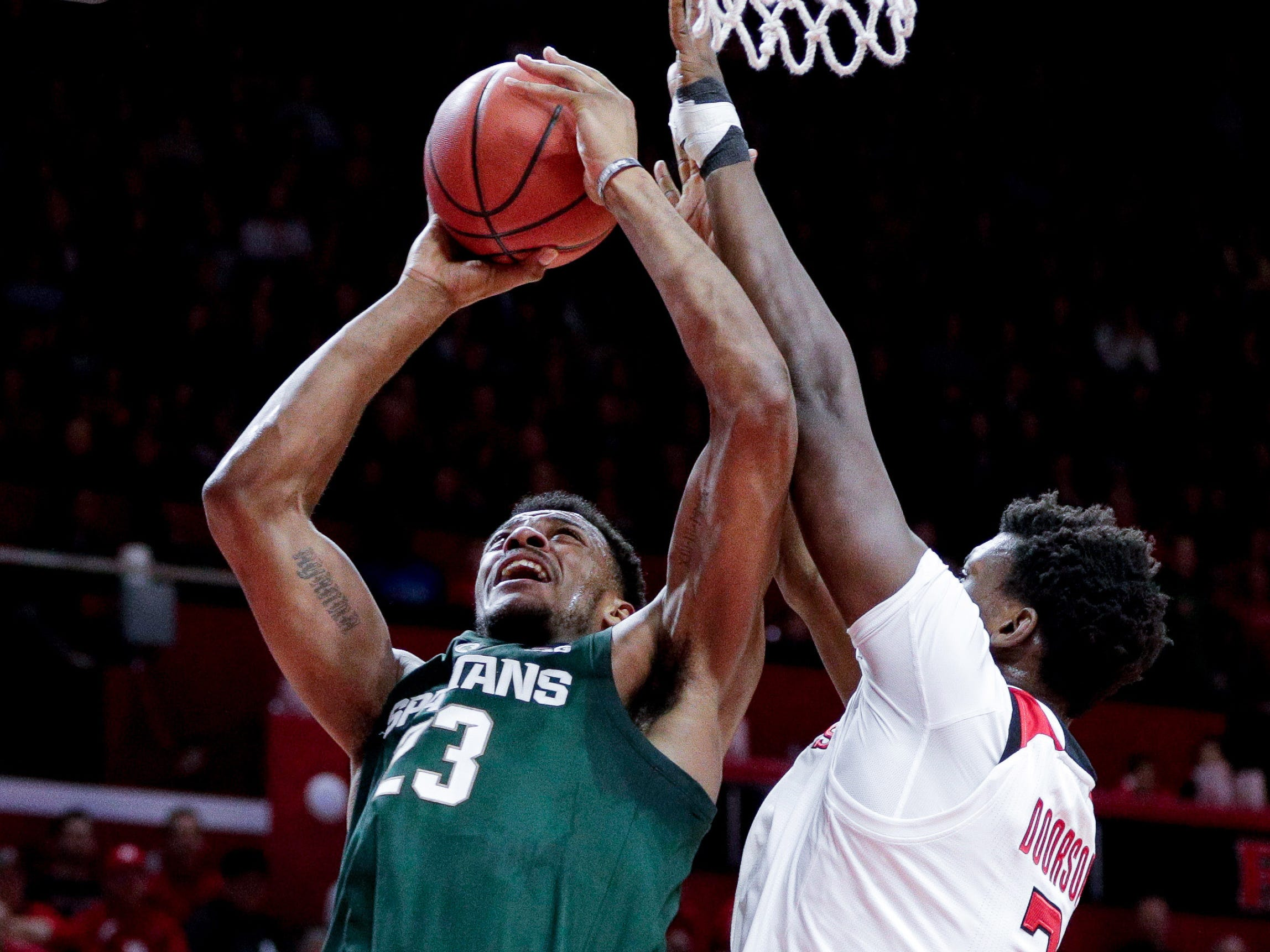 Michigan State Spartans forward Xavier Tillman (23) shoots the ball as Rutgers Scarlet Knights center Shaquille Doorson (2) defends during the first half at Rutgers Athletic Center (RAC).