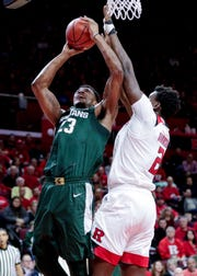 MIchigan State forward Xavier Tillman (23) had 11 points and eight rebounds over 30 minutes against Shaquille Doorson (2) and Rutgers in the Spartans' 78-67 win on Nov. 30 in Piscataway, New Jersey.
