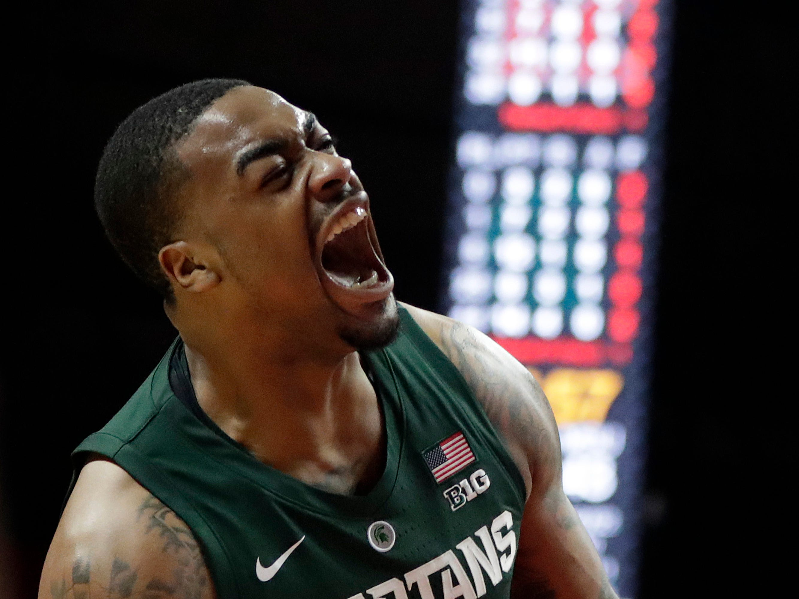 Michigan State forward Nick Ward reacts after dunking against Rutgers during the second half of an NCAA college basketball game, Friday, Nov. 30, 2018, in Piscataway, N.J.