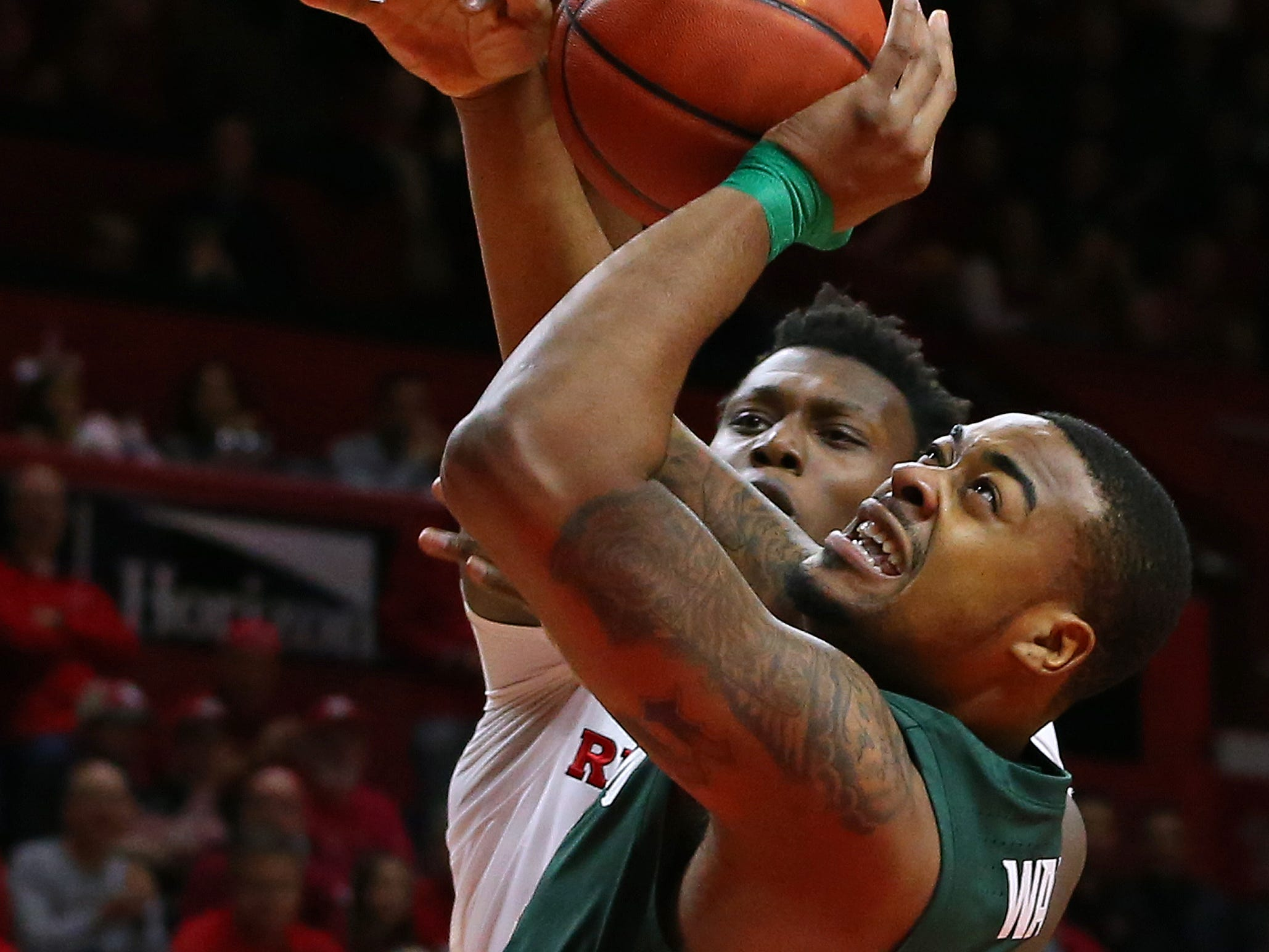 Nick Ward #44 of the Michigan State Spartans attempts a shot as Shaquille Doorson #2 of the Rutgers Scarlet Knights defends during the first half of a college basketball game at the Rutgers Athletic Center on November 30, 2018 in Piscataway, New Jersey. Michigan State defeated Rutgers 78-67.